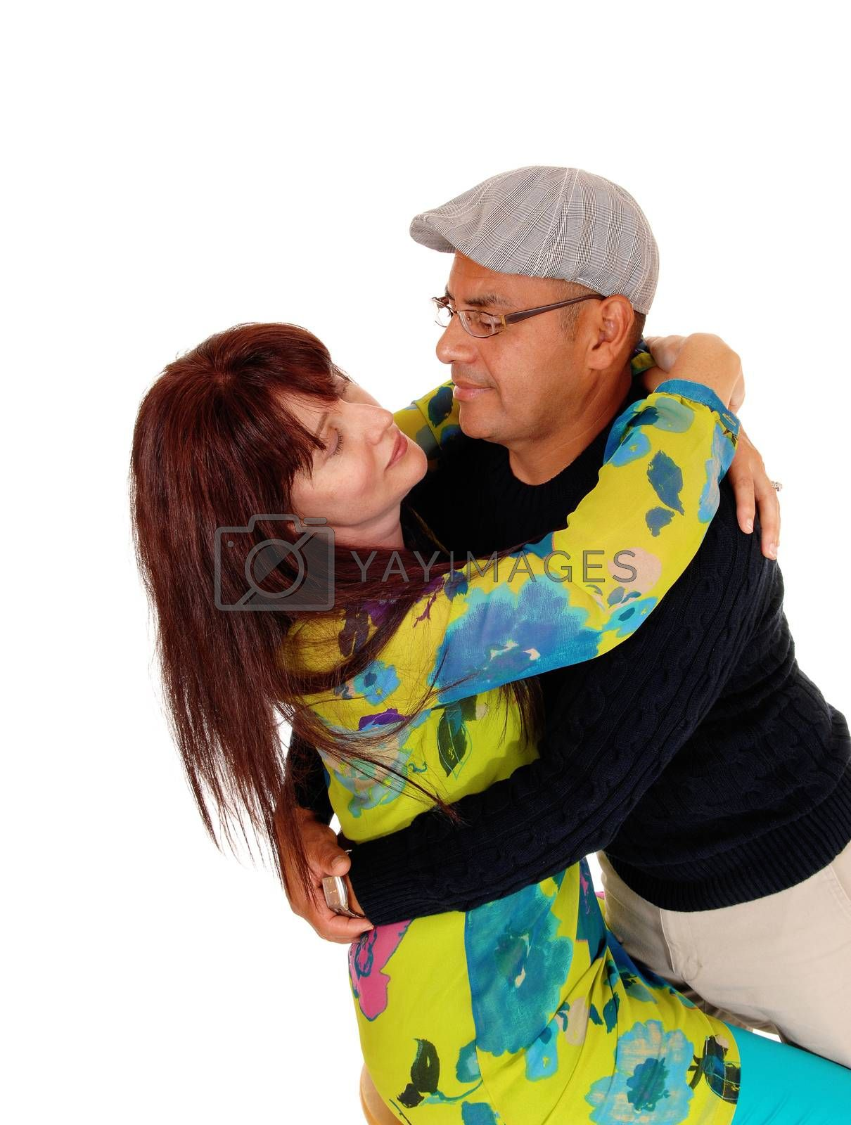 Royalty free image of Happy middle age couple joking around. by feierabend