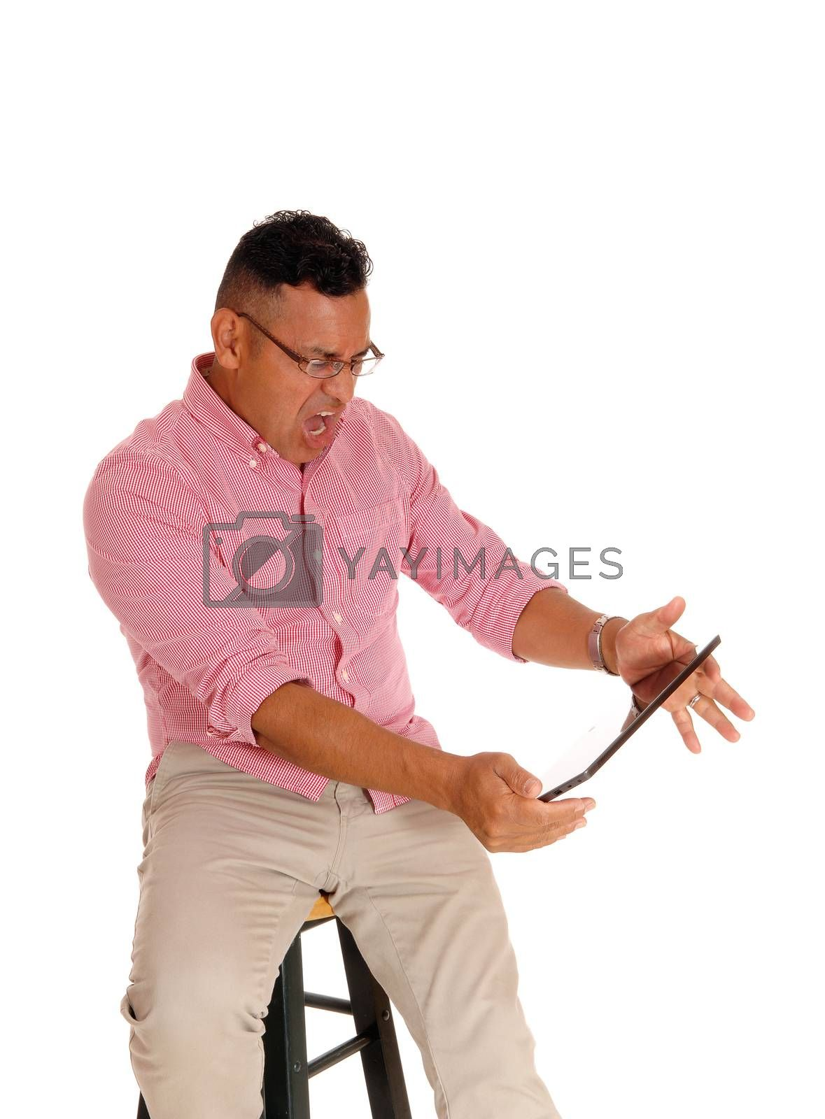 Royalty free image of Man screaming at his tablet computer. by feierabend