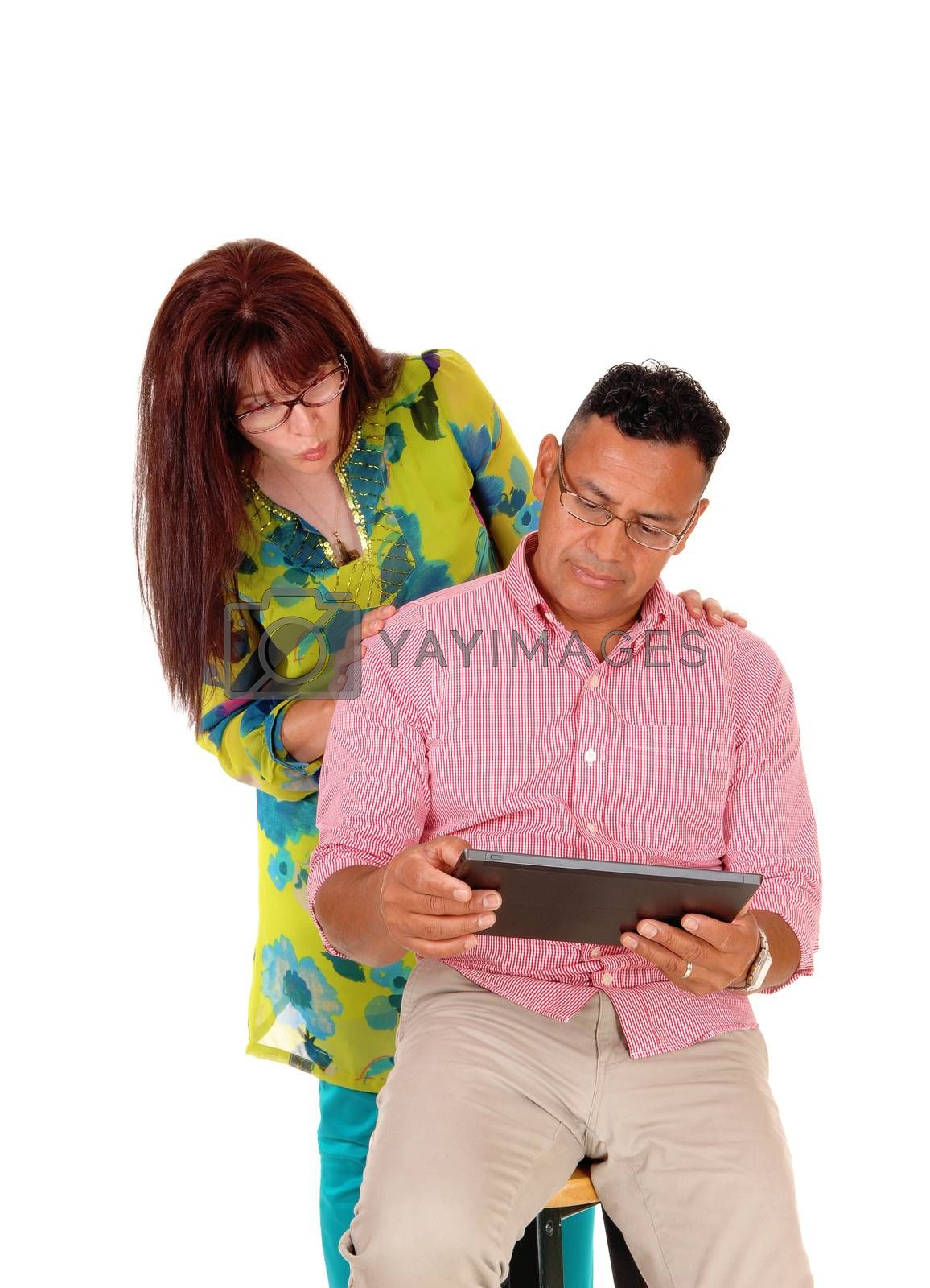 Royalty free image of Couple playing with tablet computer. by feierabend
