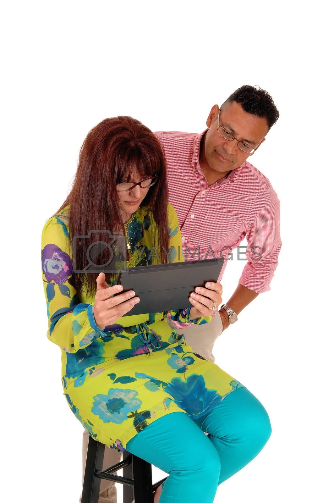 Royalty free image of Husband and wife looking at there tablet. by feierabend