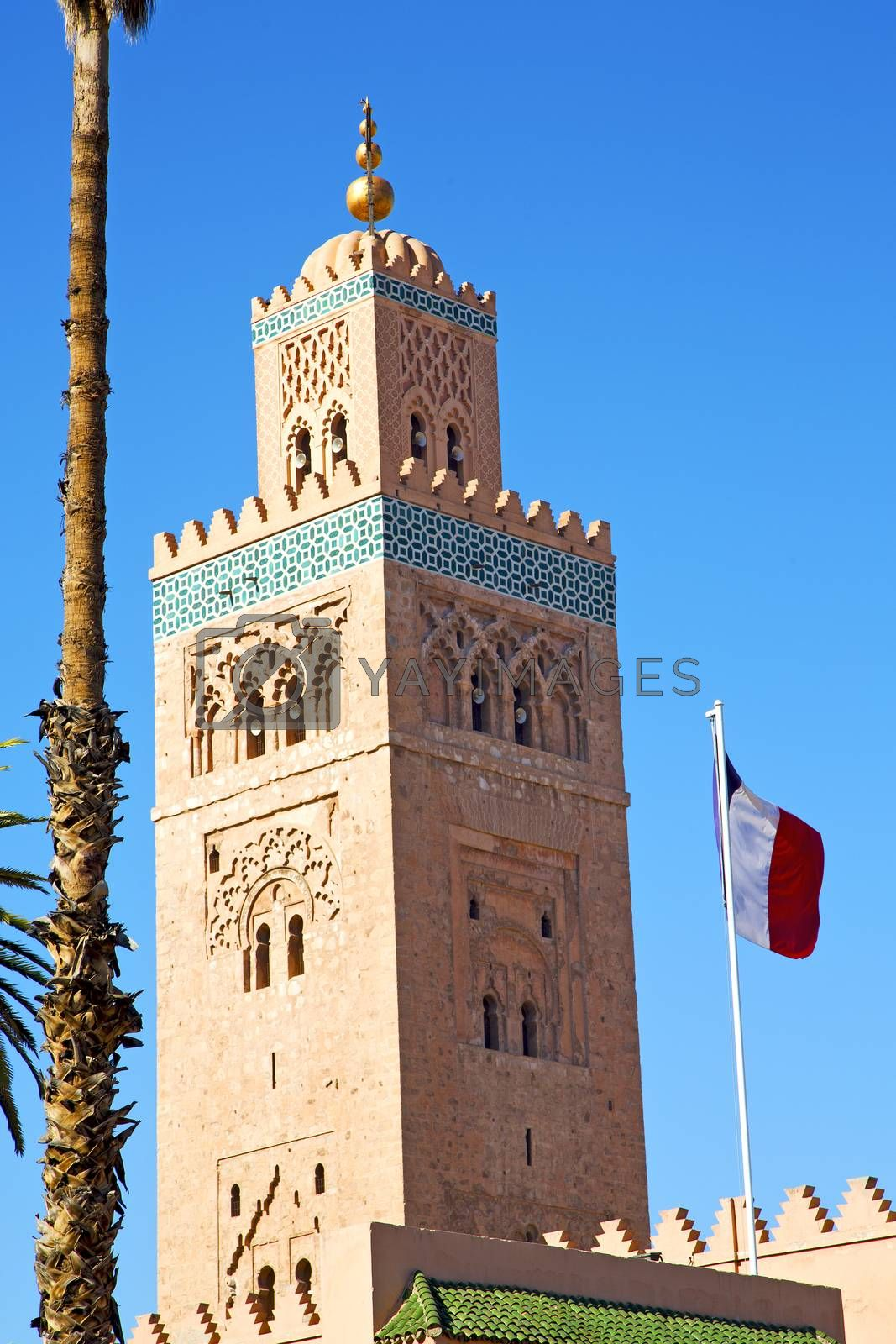 Royalty free image of history in maroc africa  minaret waving flag by lkpro