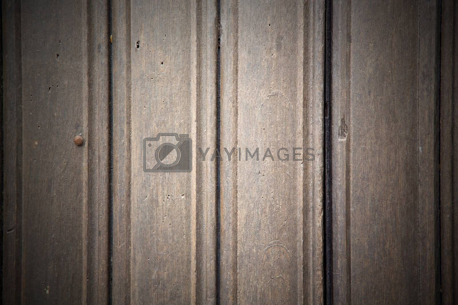 in london antique brown door  rusty  brass nail and light by lkpro