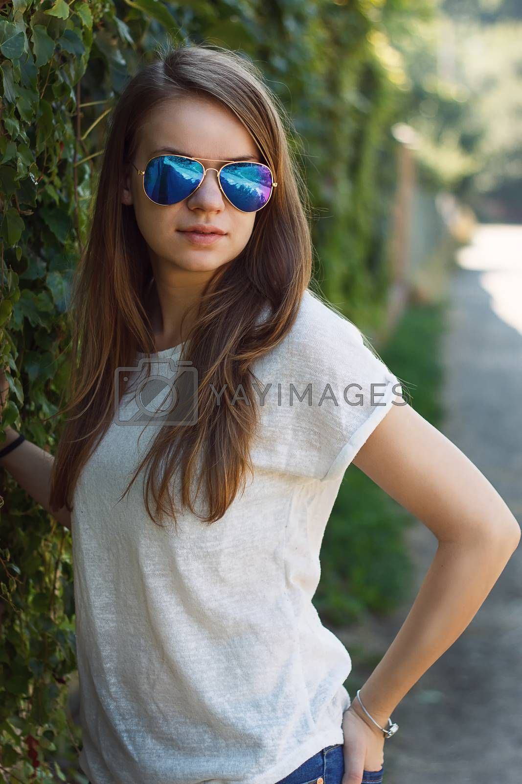 Royalty free image of Beautiful smiling girl in white blouse by victosha