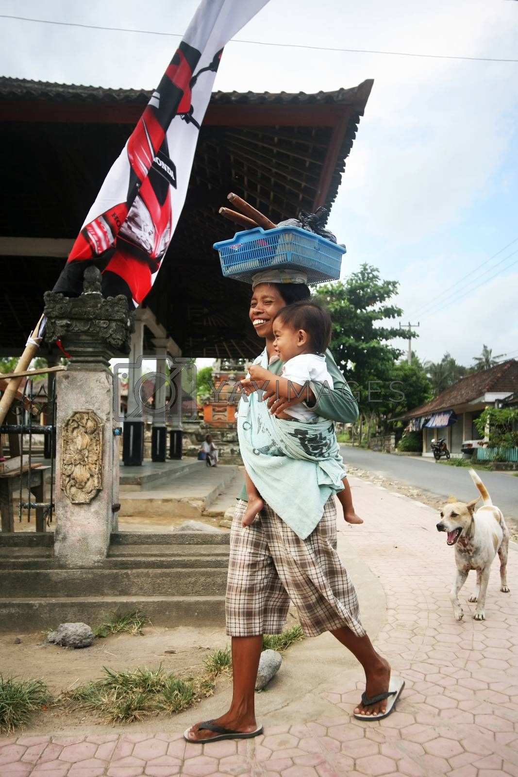 Ubud, Indonesia - October 30, 2007: The Indonesian woman with a small daughter in balines to a village on Bali