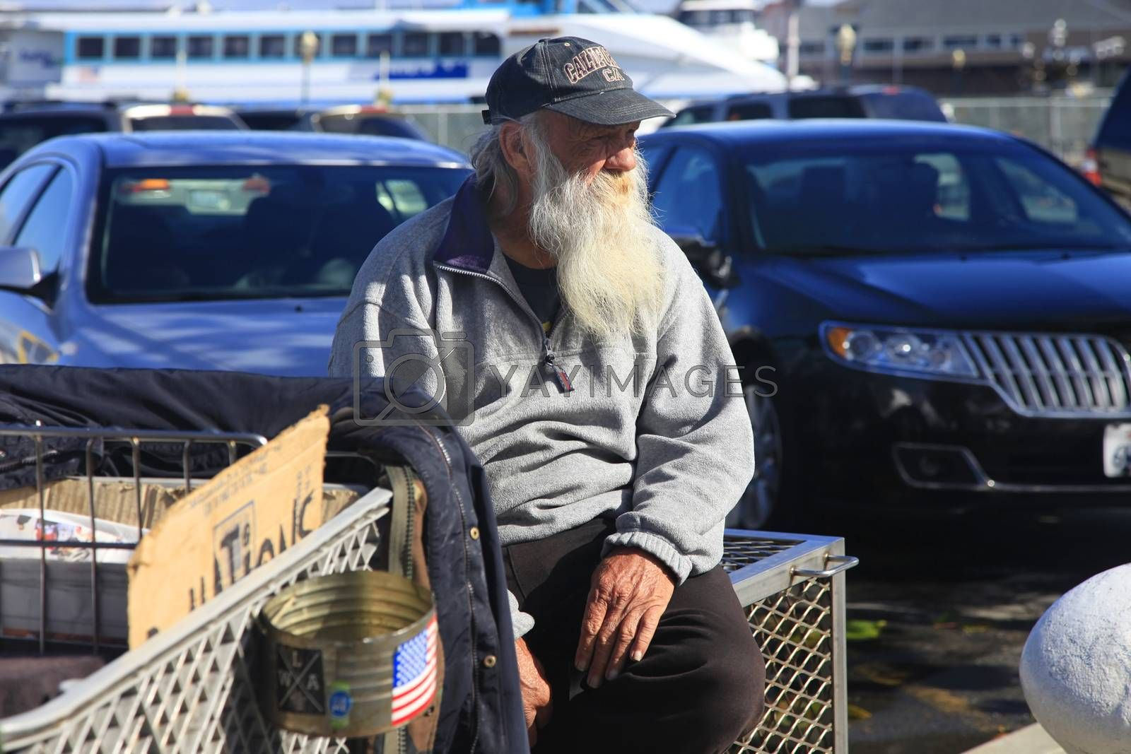 San Francisco, CA, USA - October 22, 2012: Homeless Man with Shopping Cart on the streets in San Francisco. He carries all of his belongings with him in a shopping cart