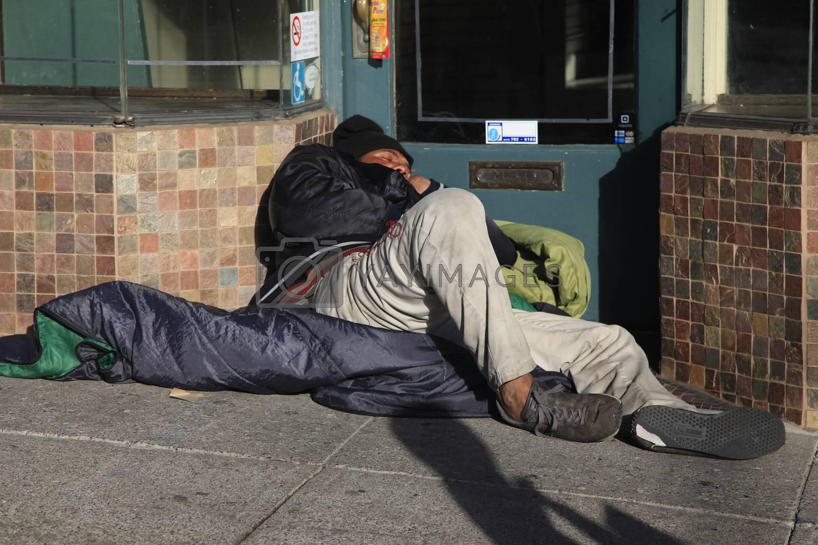 San Francisco, CA, USA - October 23, 2012: Homeless man sleeps on the street Castro in the center of San Francisco