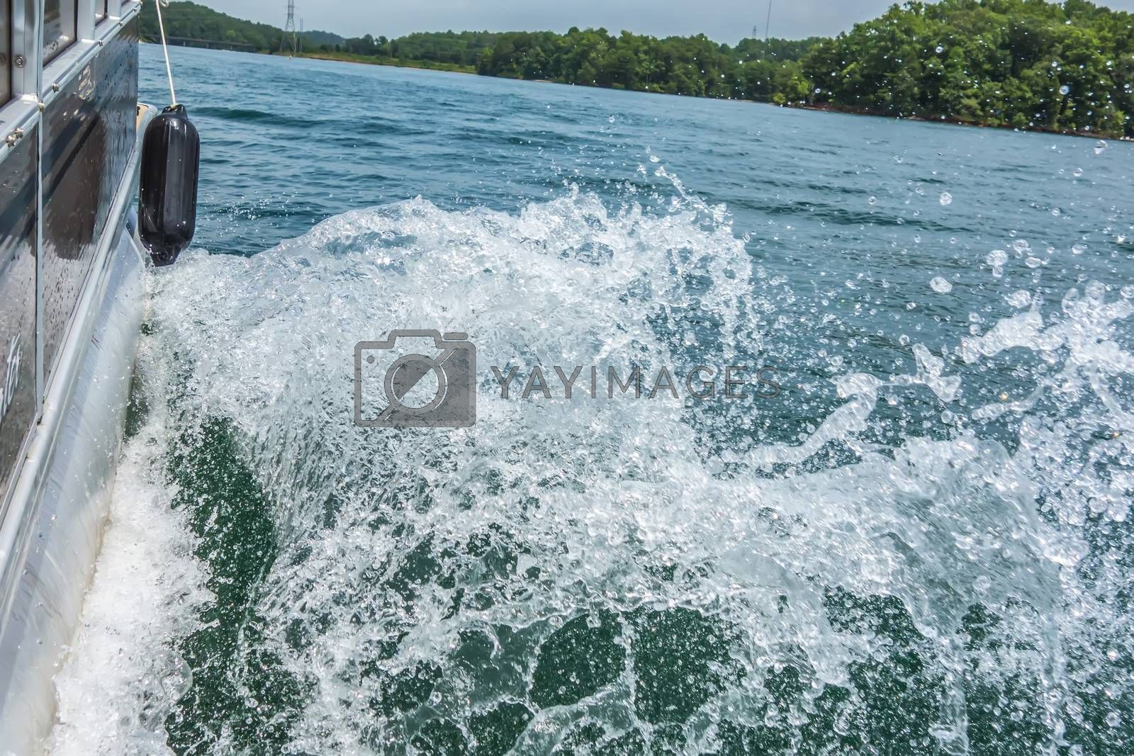 Royalty free image of Waves on lake behind the speed boat   by digidreamgrafix