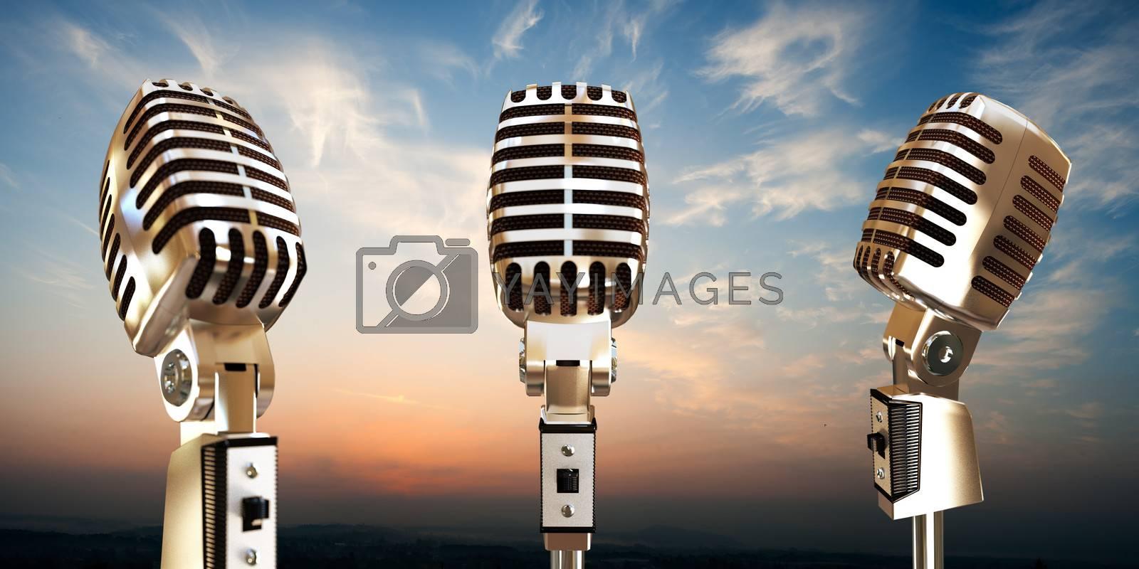 vintage microphones on sunset background