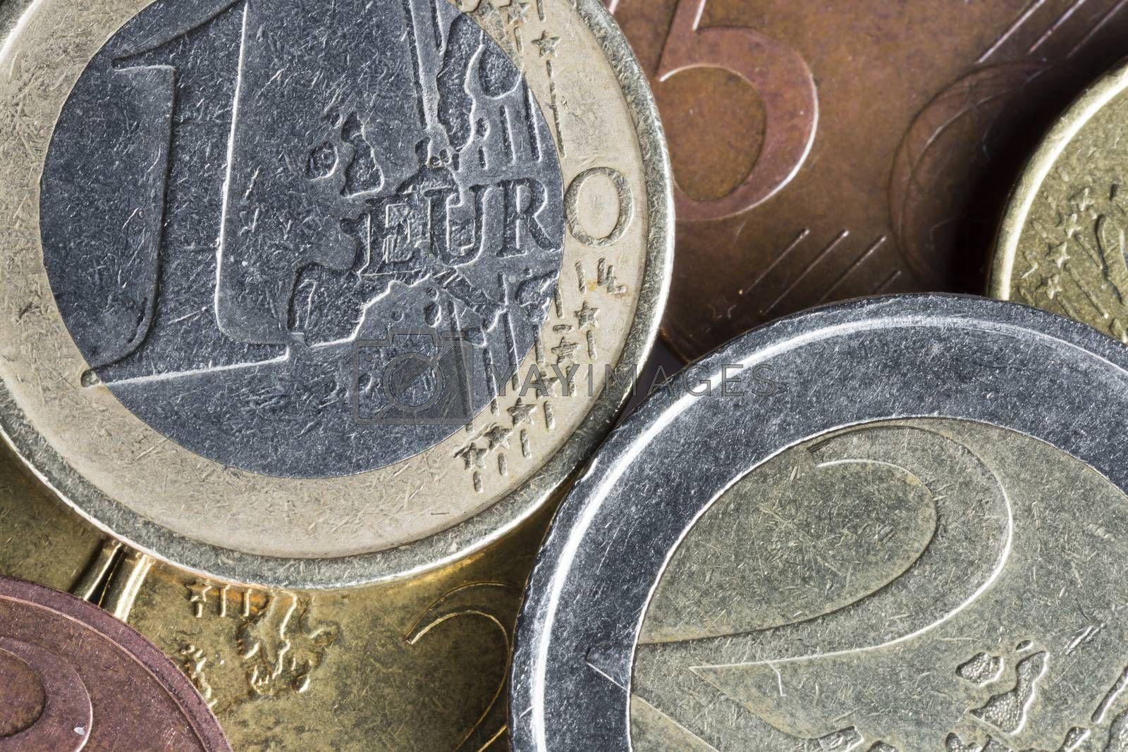 Euro Coins on Top of Each Other with the one Euro and the 2 Euro being most prominent.