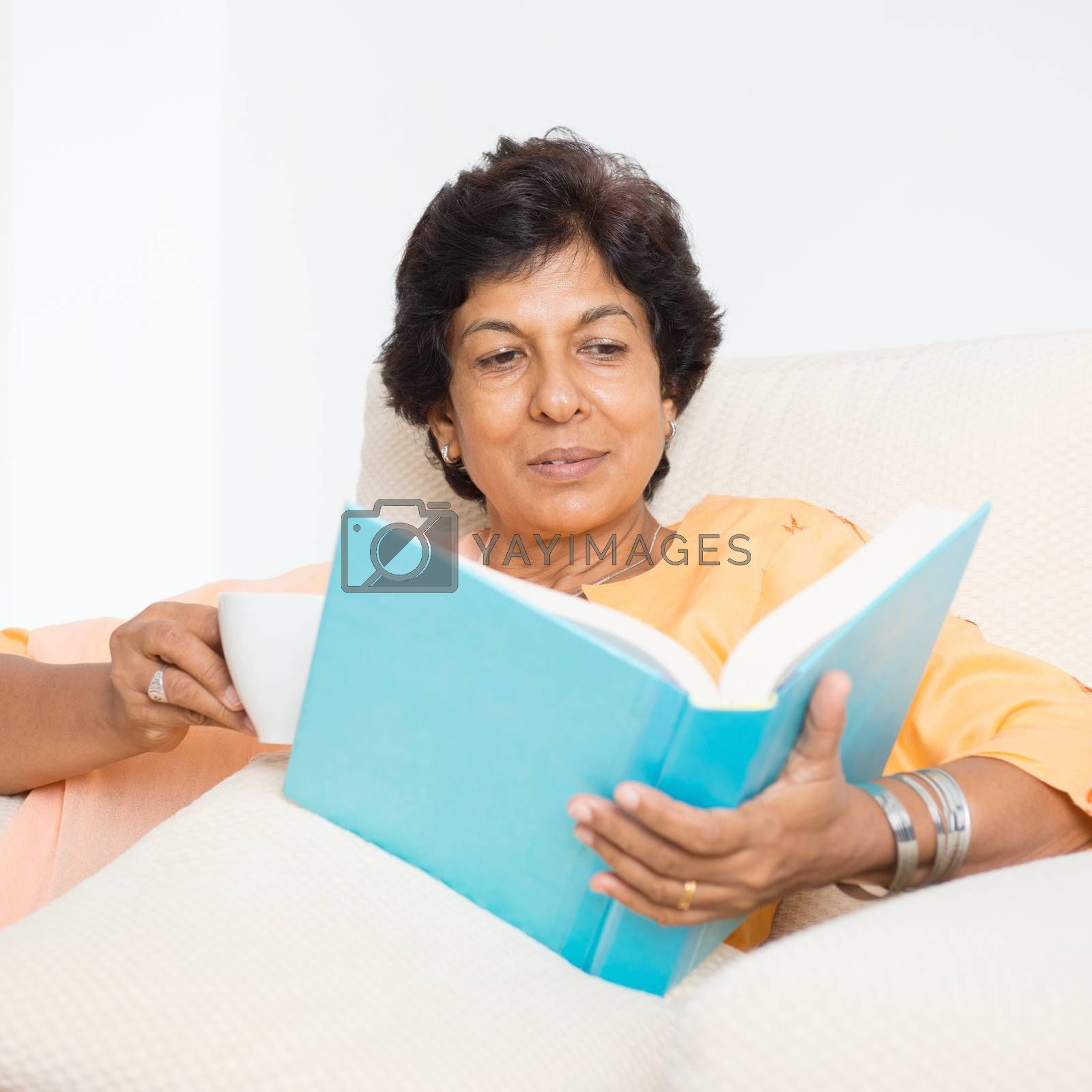 Indian mature woman reading book by szefei
