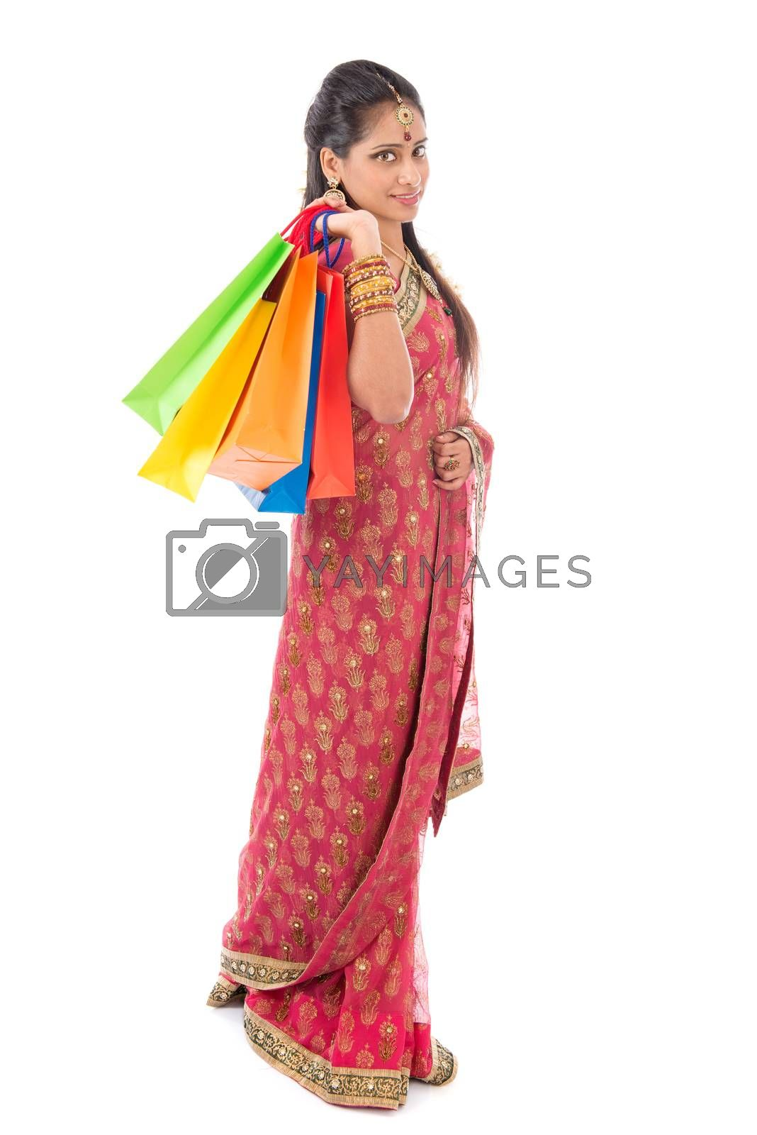 Indian people in traditional sari shopping for diwali festival, full length standing isolated on white background.