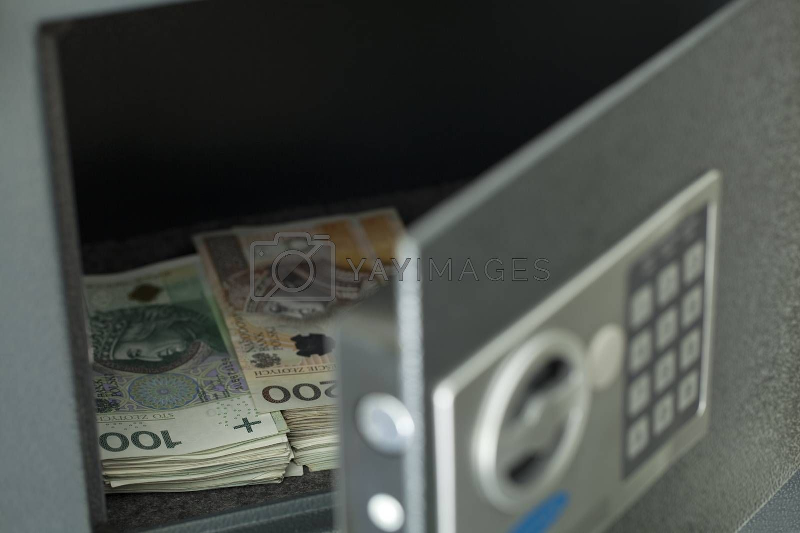 open safe full with Polish notes (hundred and two zloty)