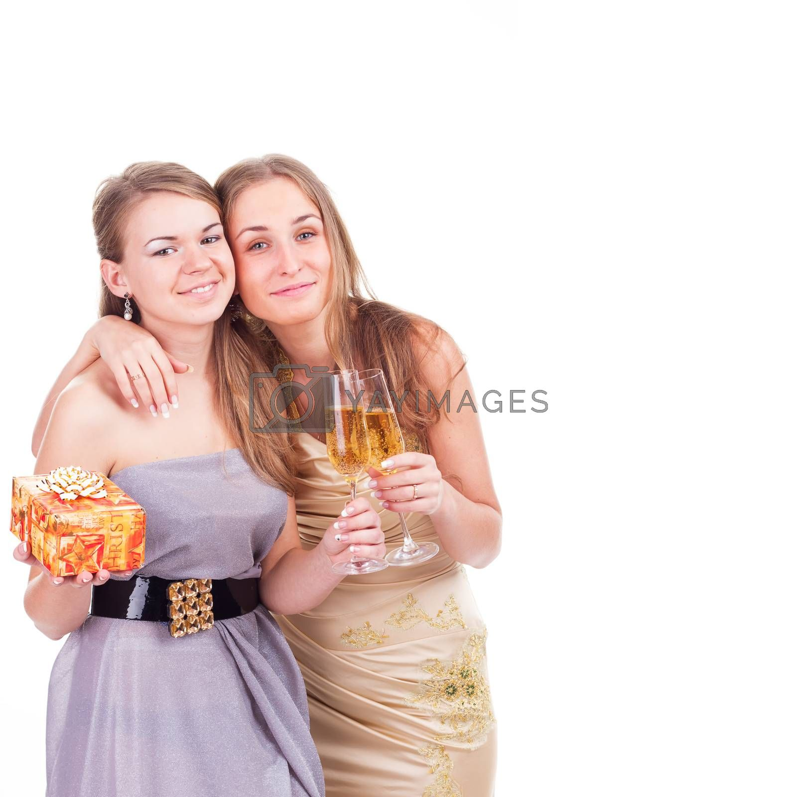 Two young beautiful blonde women celebrating birthday or christmas