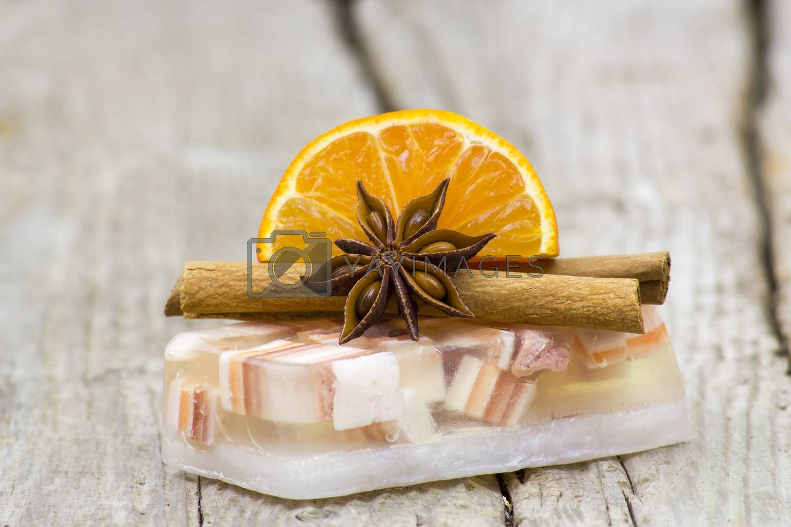 aromatic glycerin soap, orange and spices on wooden background
