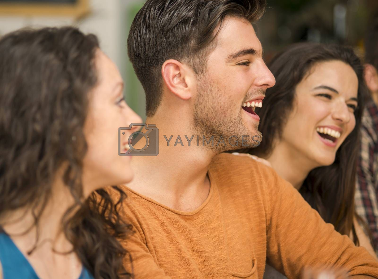 Multi-Ethnic Group of happy friends having fun at the restaurant