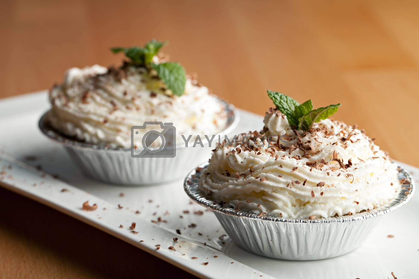 Parfait desserts with fresh whipped cream and chocolate shavings. Shallow depth of field.