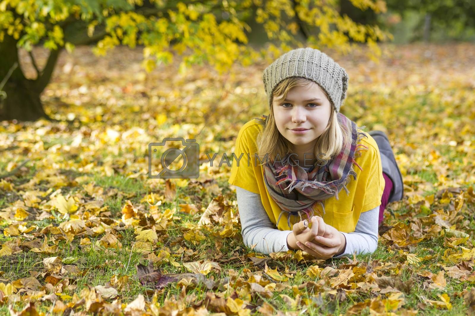young girl in the autumn park by miradrozdowski