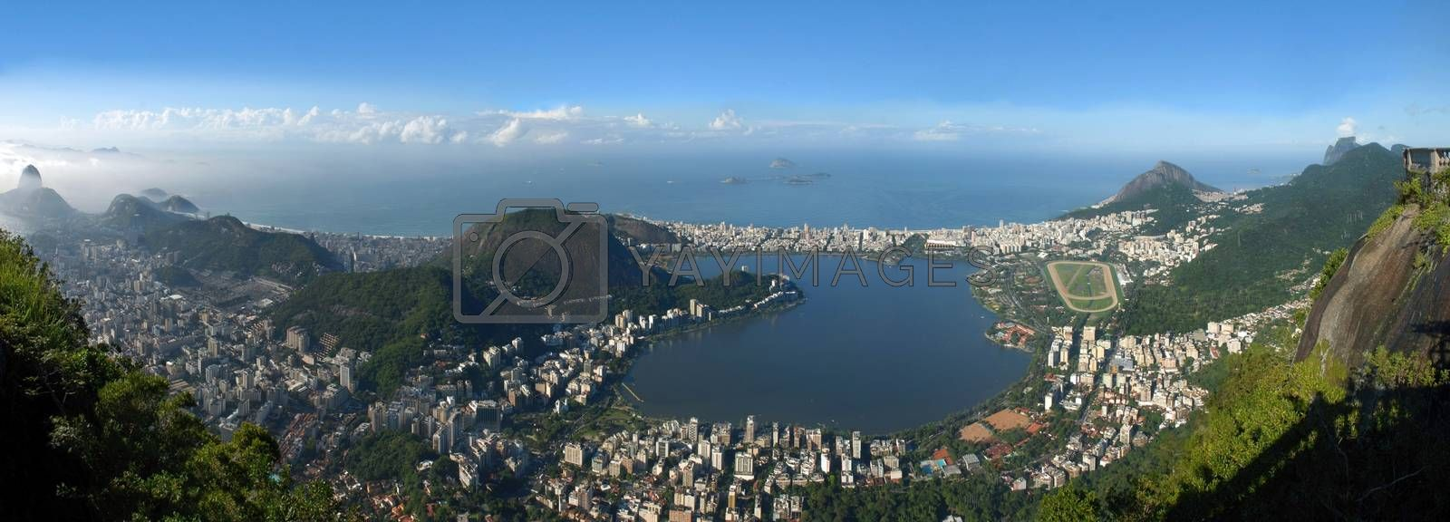 Panoramic view of Rio De Janeiro, sky, city and seashore view from Christ the Redeemer. Brazil landscape.