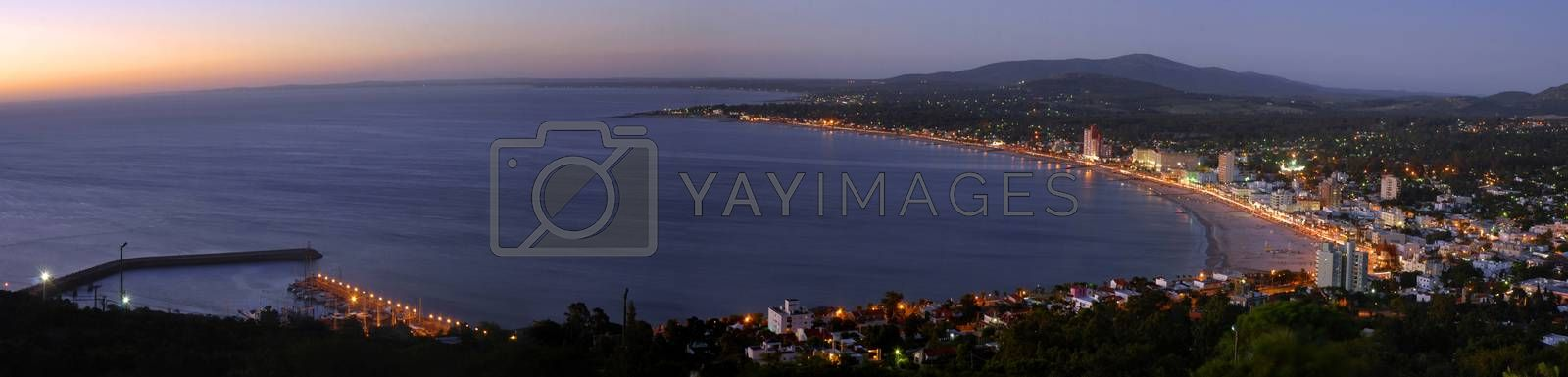Summer beach panoramic cityscape with clear sunset and seashore aerial view. Piriapolis, Uruguay.