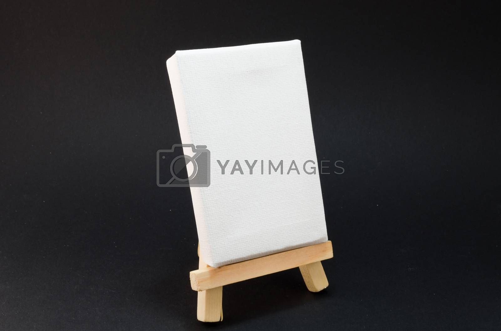 Miniature artist easel, isolated against a black background.