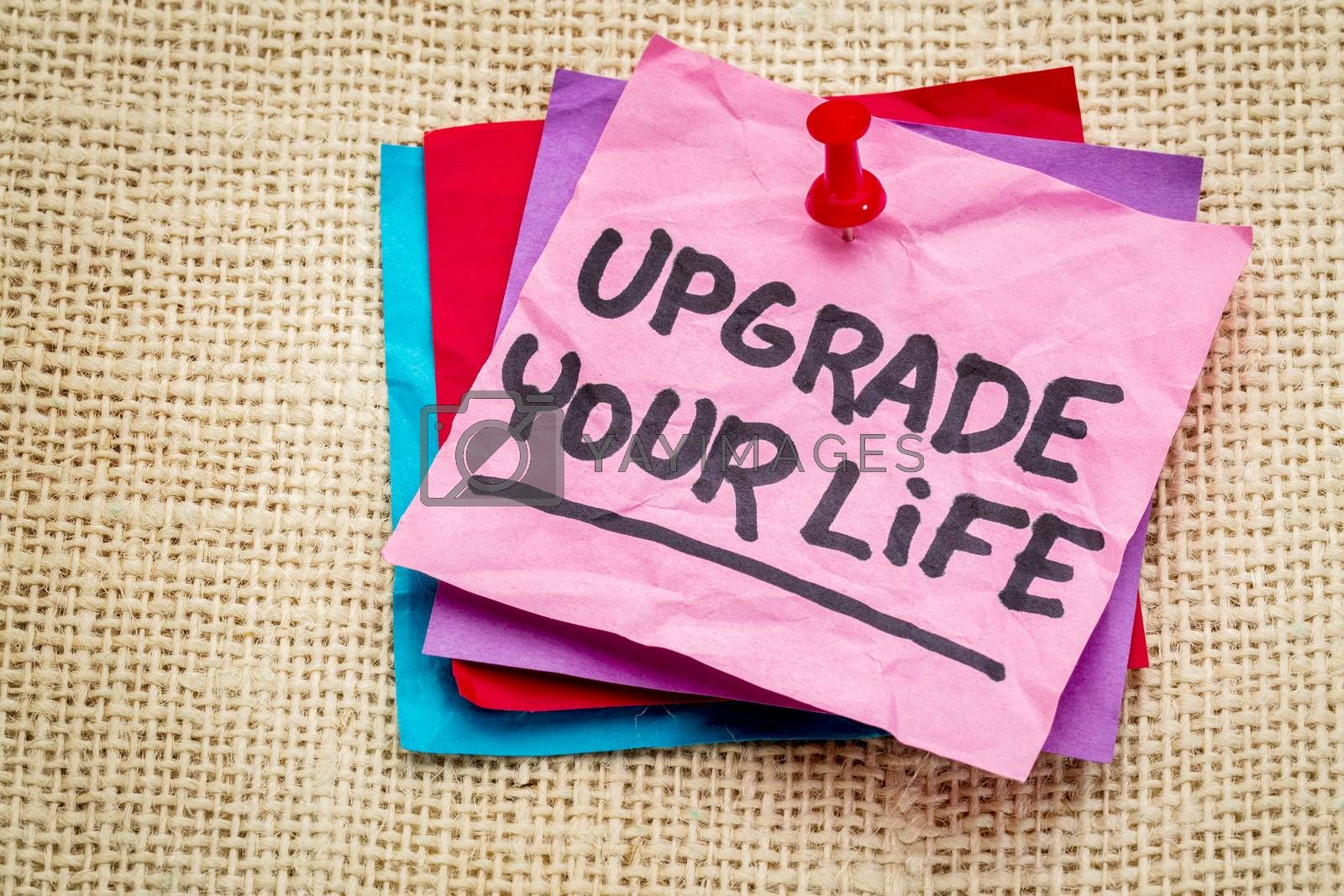 upgrade your life advice - motivational text on a sticky note