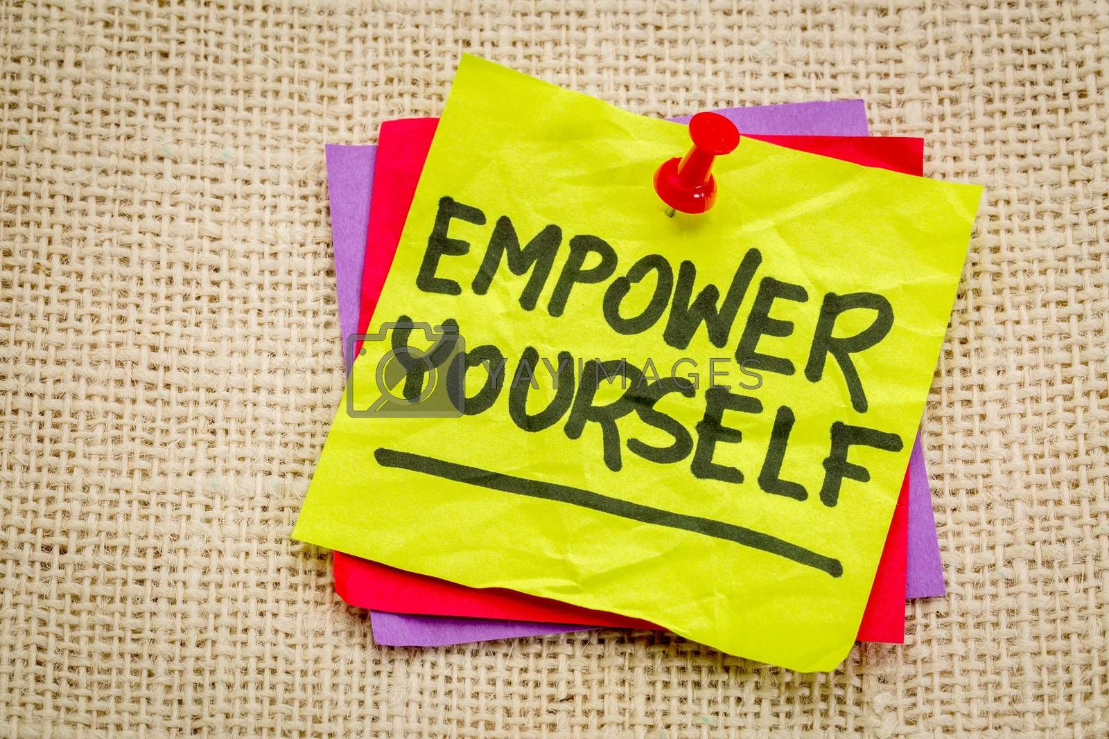 empower yourself reminder - motivational text on a sticky note