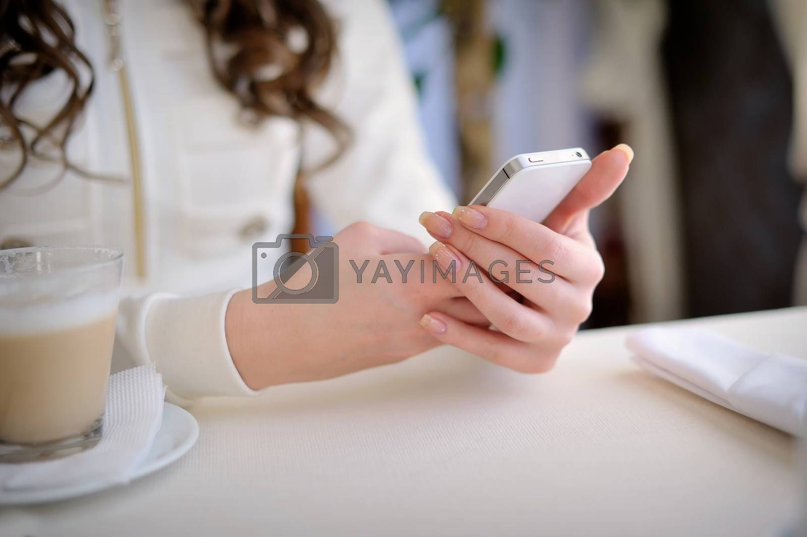 Close up of hands woman using cell phone.