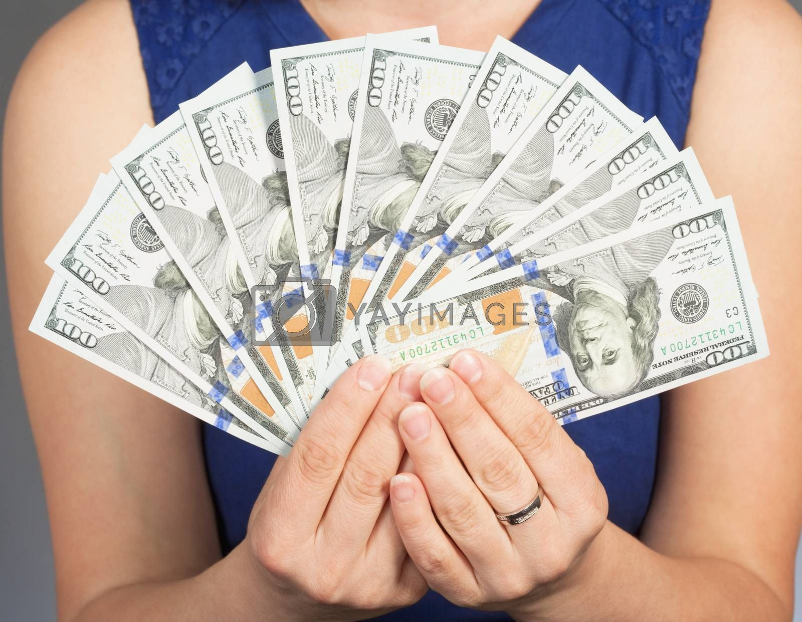 Royalty free image of Woman Holding New 100 US Dollar Bills by courtyardpix
