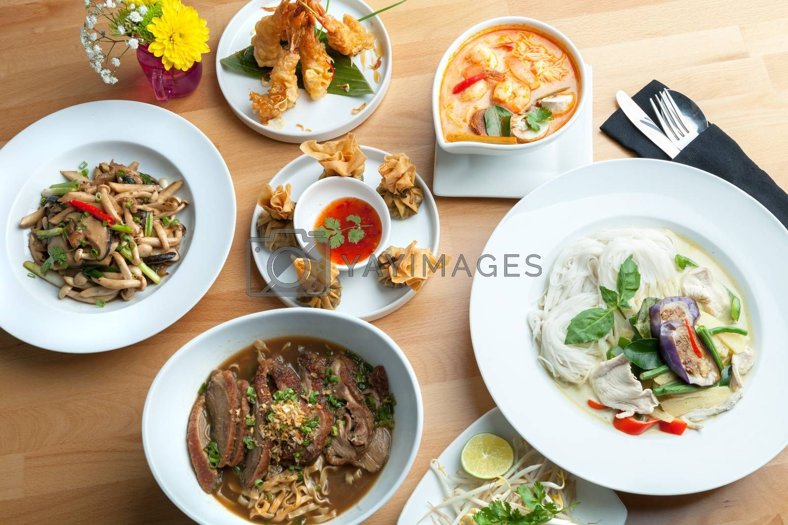 Variety of authentic Thai cuisine curries and stir fry dishes.  Shallow depth of field.