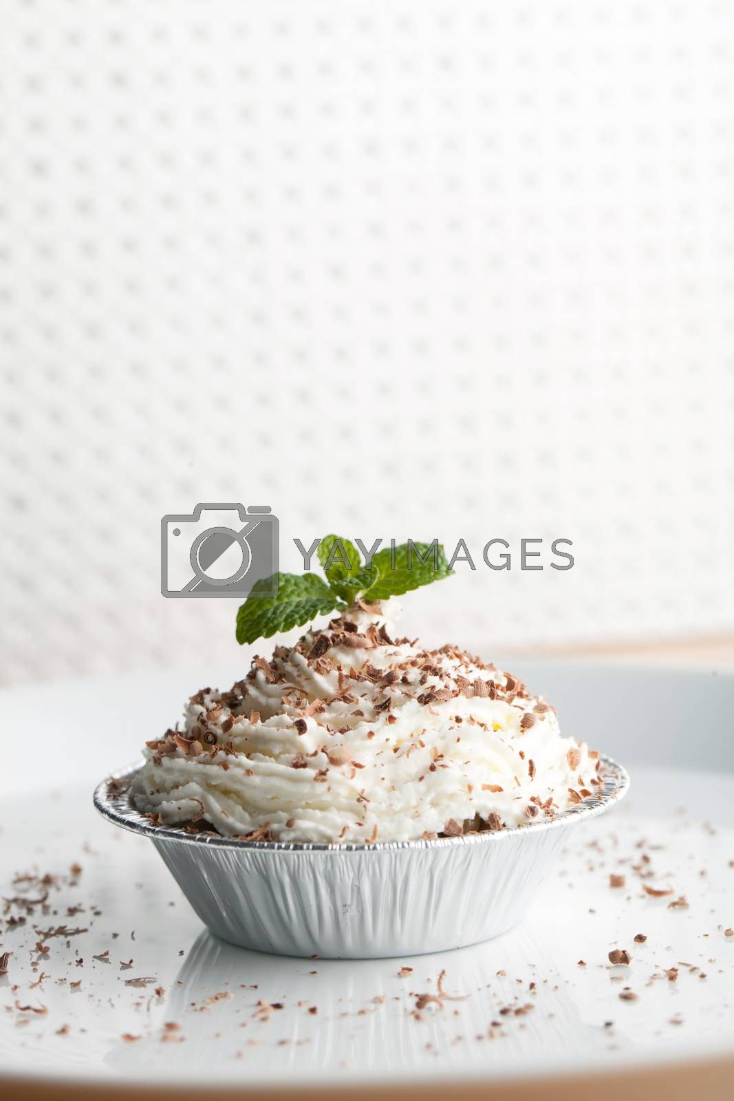 Parfait dessert with fresh whipped cream and chocolate shavings. Shallow depth of field.