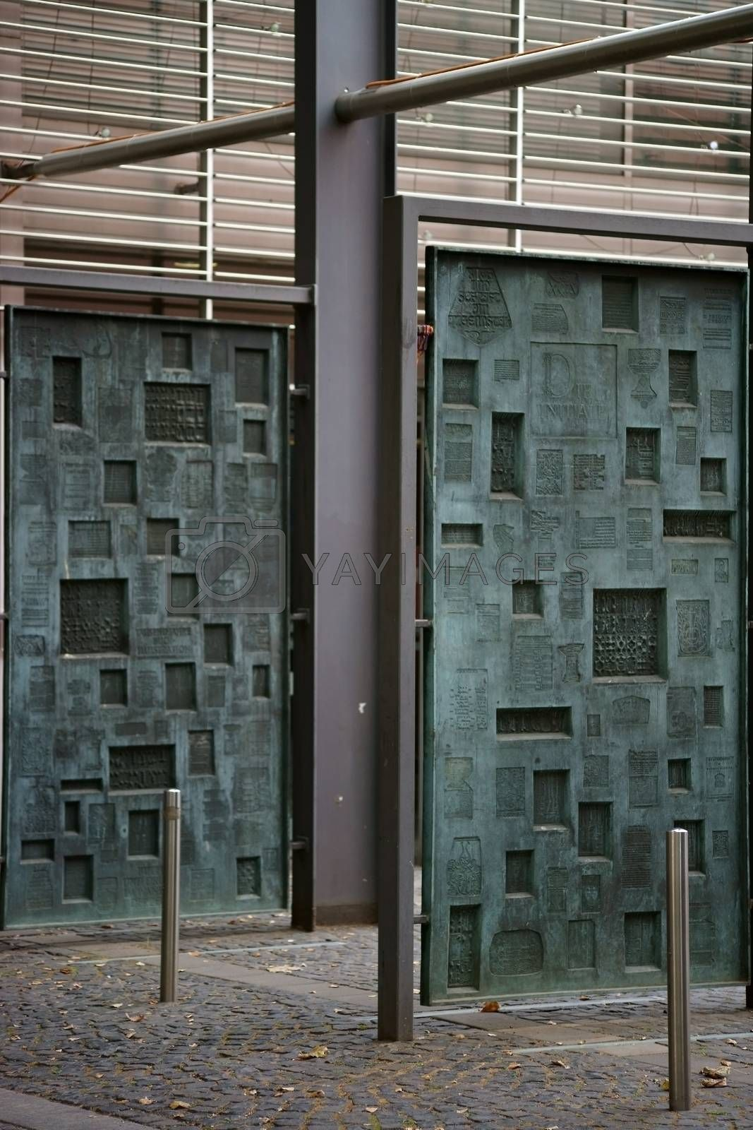 Mainz, Germany - September 04, 2015: Hanging printing plates made of copper with different motives and characters in the courtyard of the Gutenberg Museum on September 04, 2015 in Mainz.