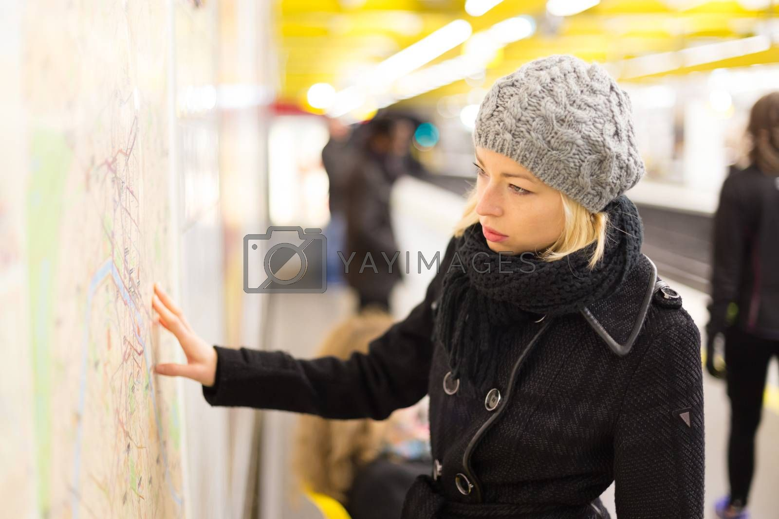 Royalty free image of Lady looking on public transport map panel. by kasto