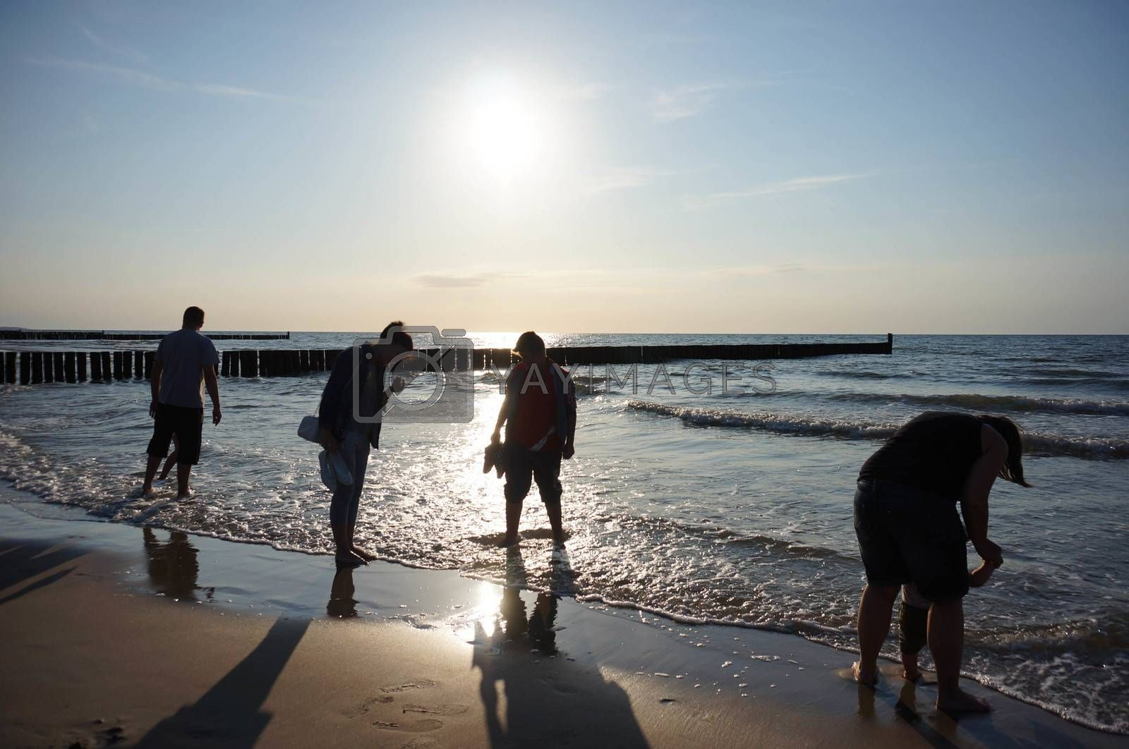 SIANOZETY, POLAND - JULY 18, 2015: Peope standing by the water at a beach in the evening