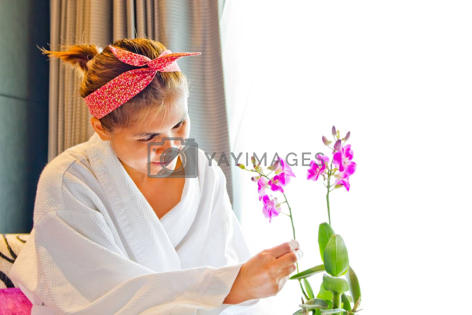 Lady wearing nightgown and flower arrangement in the morning