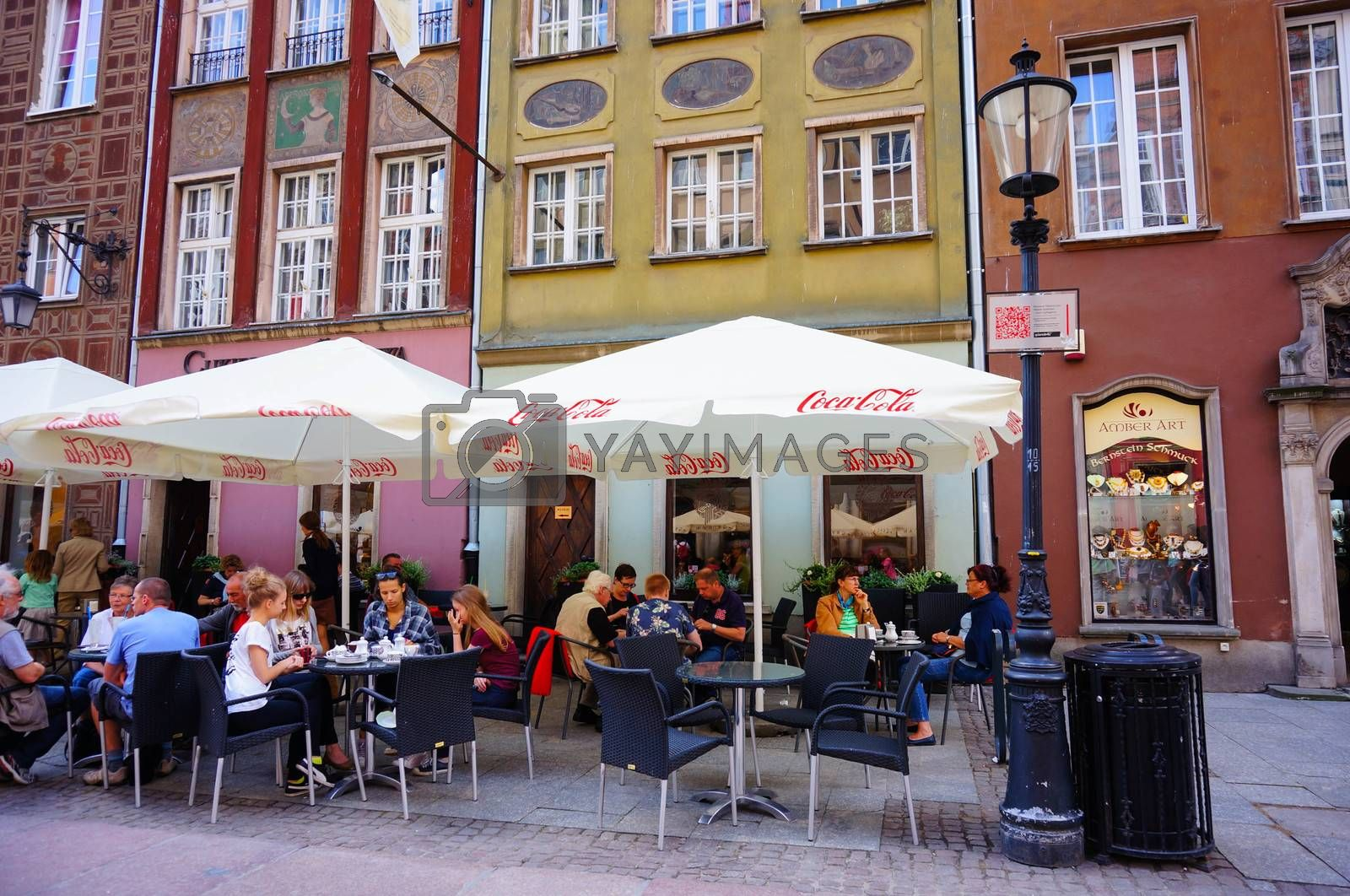 GDANSK, POLAND - JULY 29, 2015: People sitting at a bar in the city center