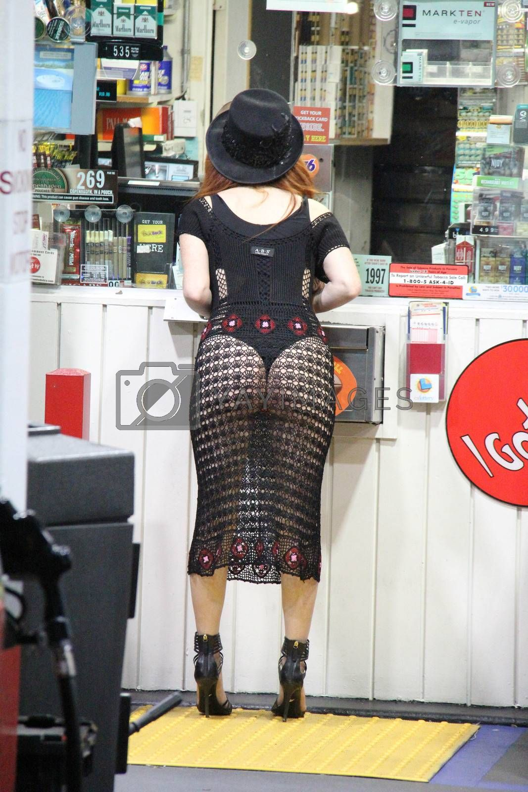 Phoebe Price stops to get gas at night while wearing a revealing, see-thru dress, Los Feliz, Los Angeles, CA 09-22-15/ImageCollect by ImageCollect