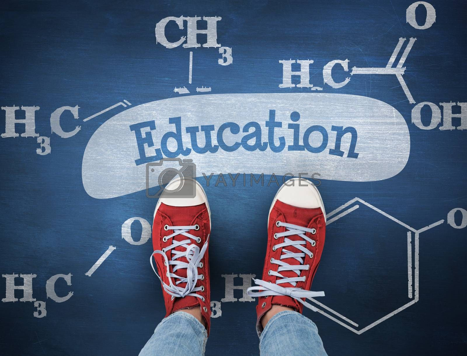 The word education and casual shoes against blue chalkboard