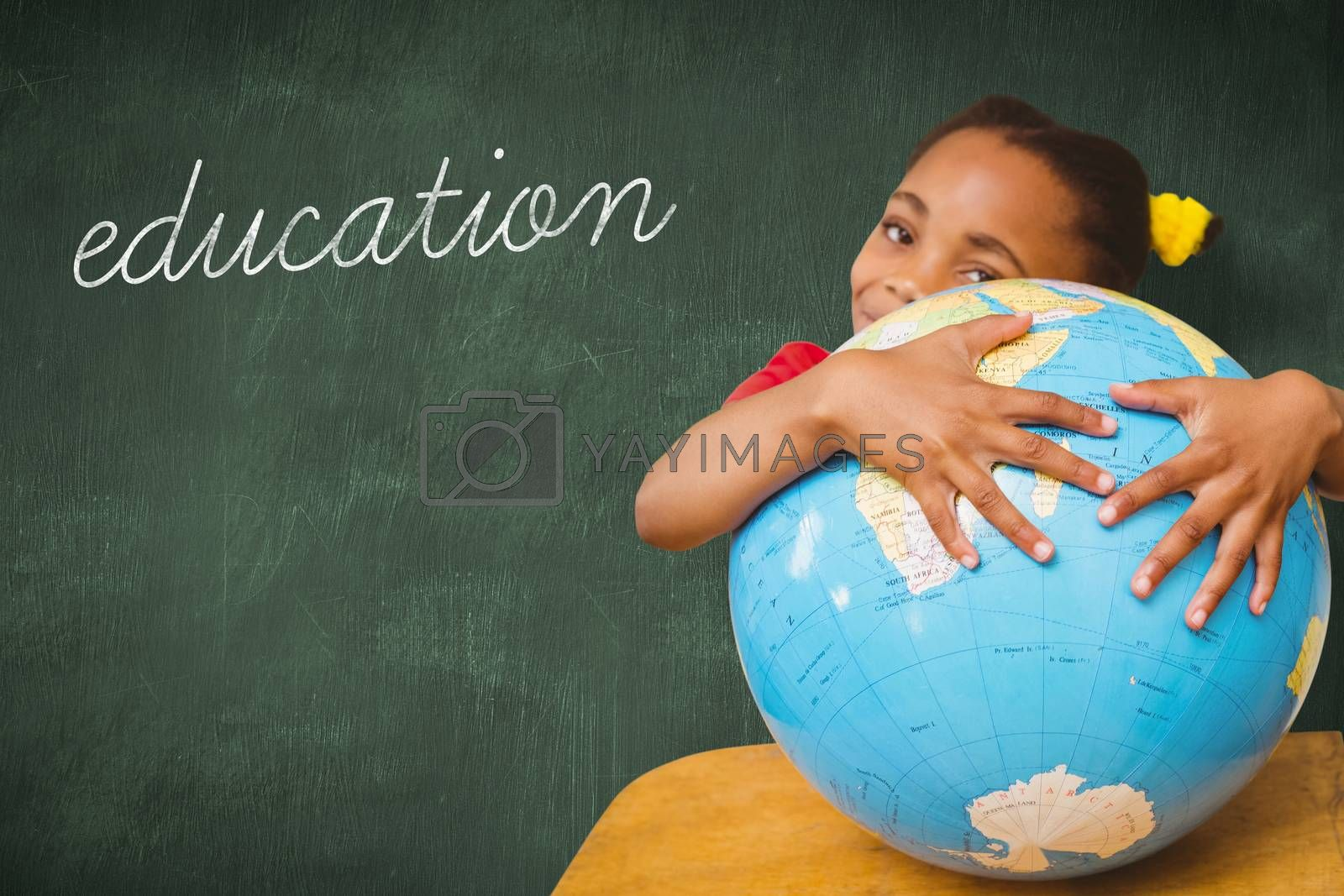 The word education and pupil hugging globe against green chalkboard