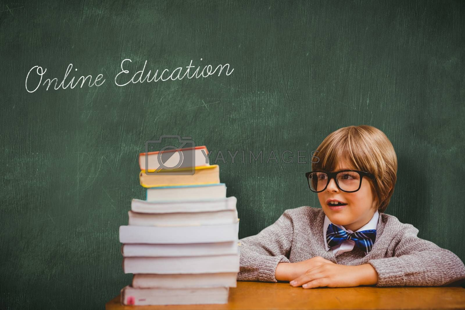 The word online education and cute pupil with pile of books against green chalkboard