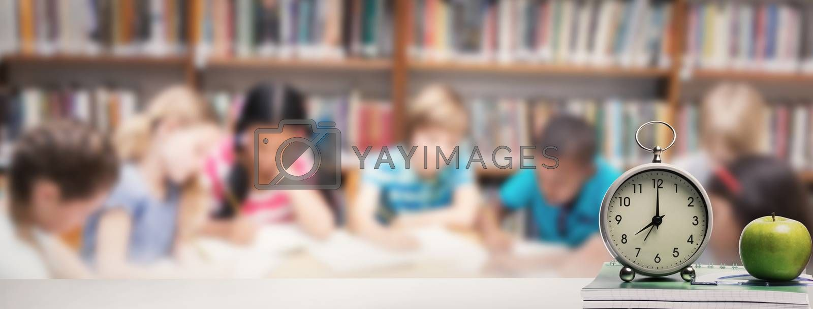 desk against cute pupils writing at desk in library