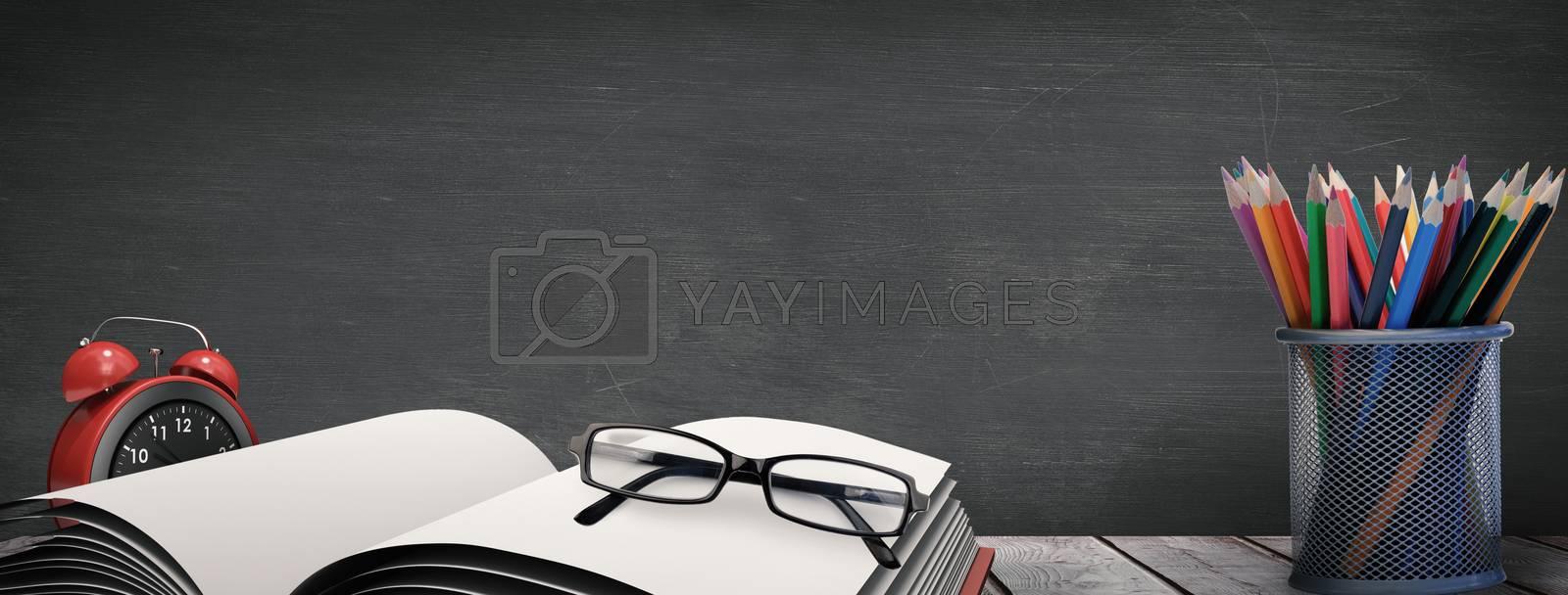 School supplies on desk against black background