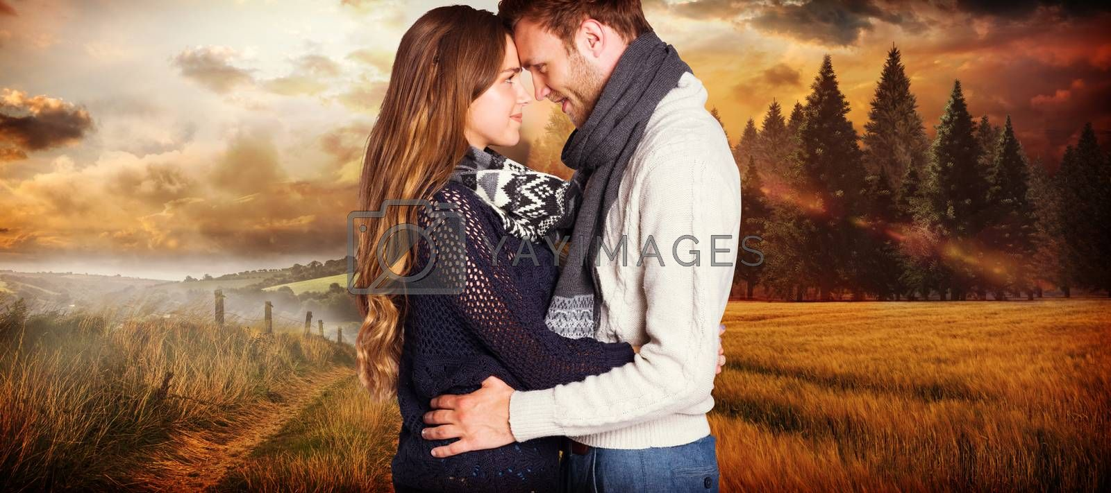 Side view of young couple embracing against country scene