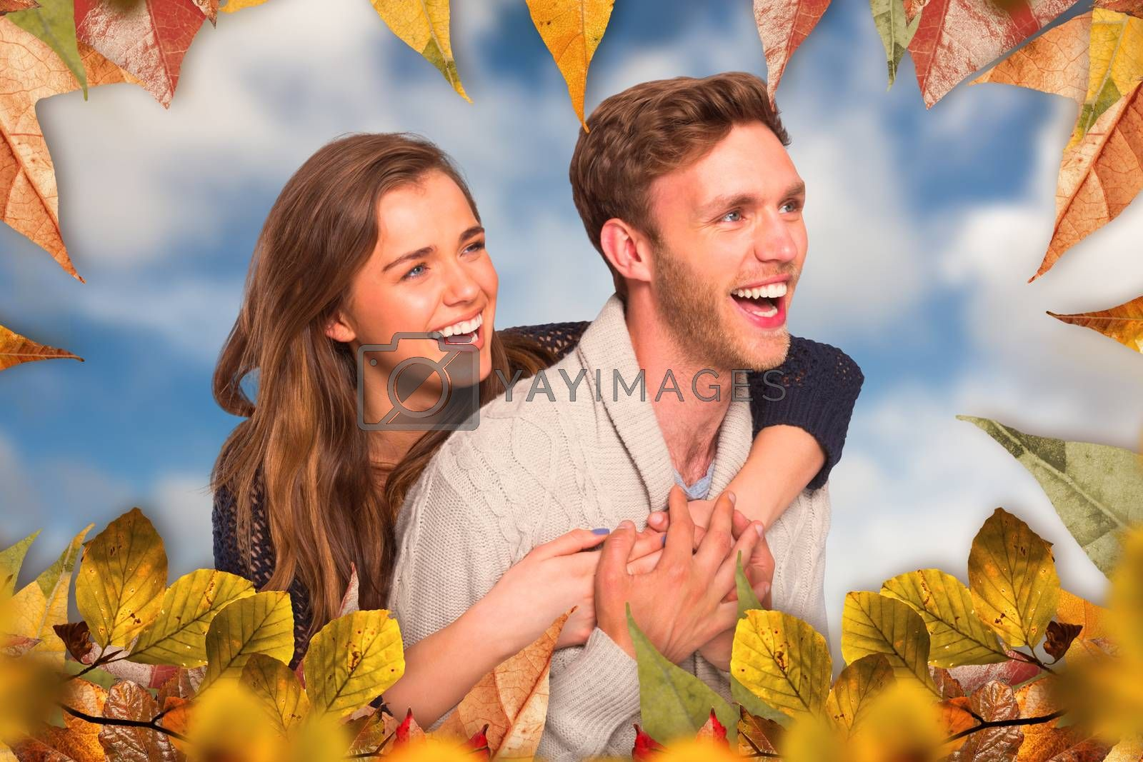 Composite image of cheerful young couple embracing by Wavebreakmedia