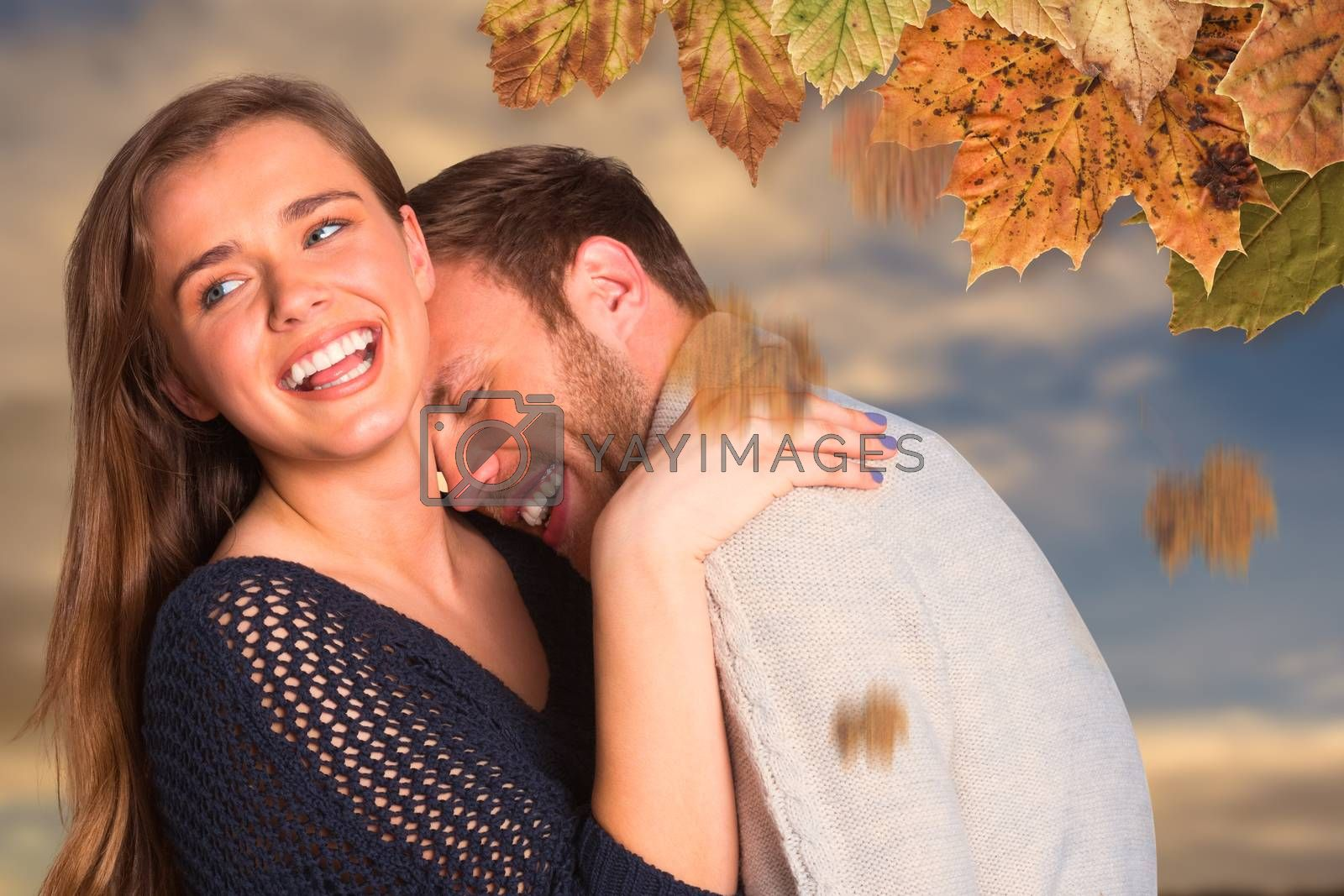 Close up of happy young couple against cloudy sky
