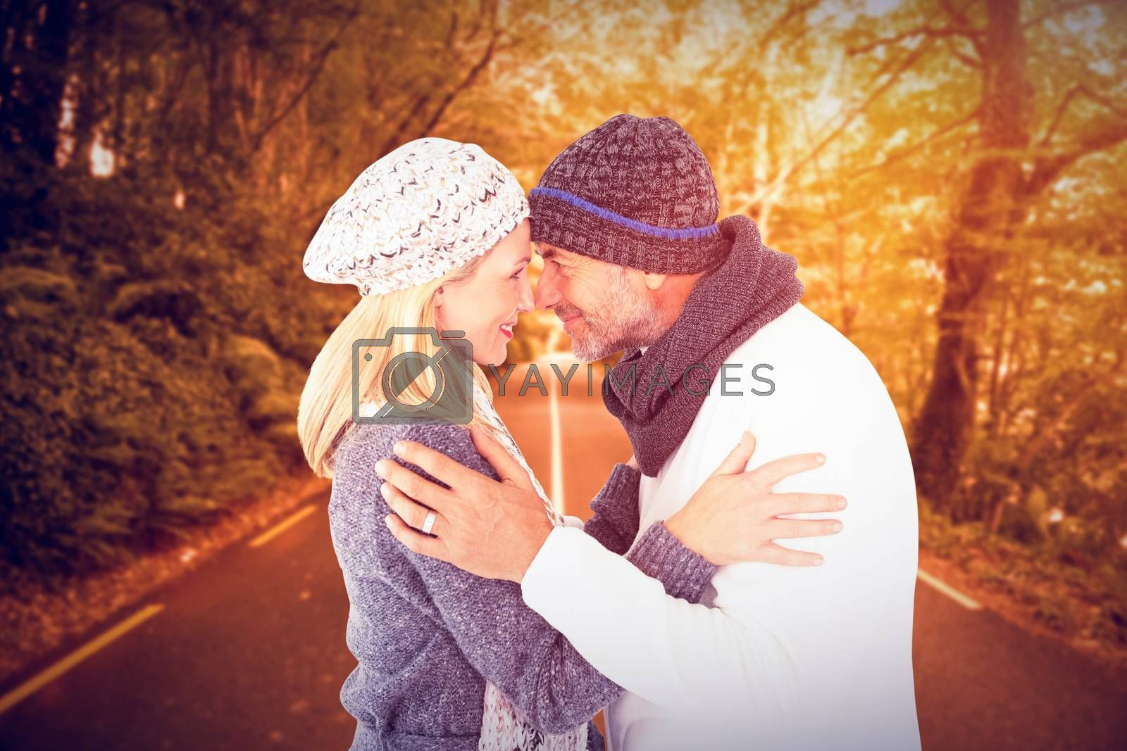 Smiling cute couple romancing over white background against country road