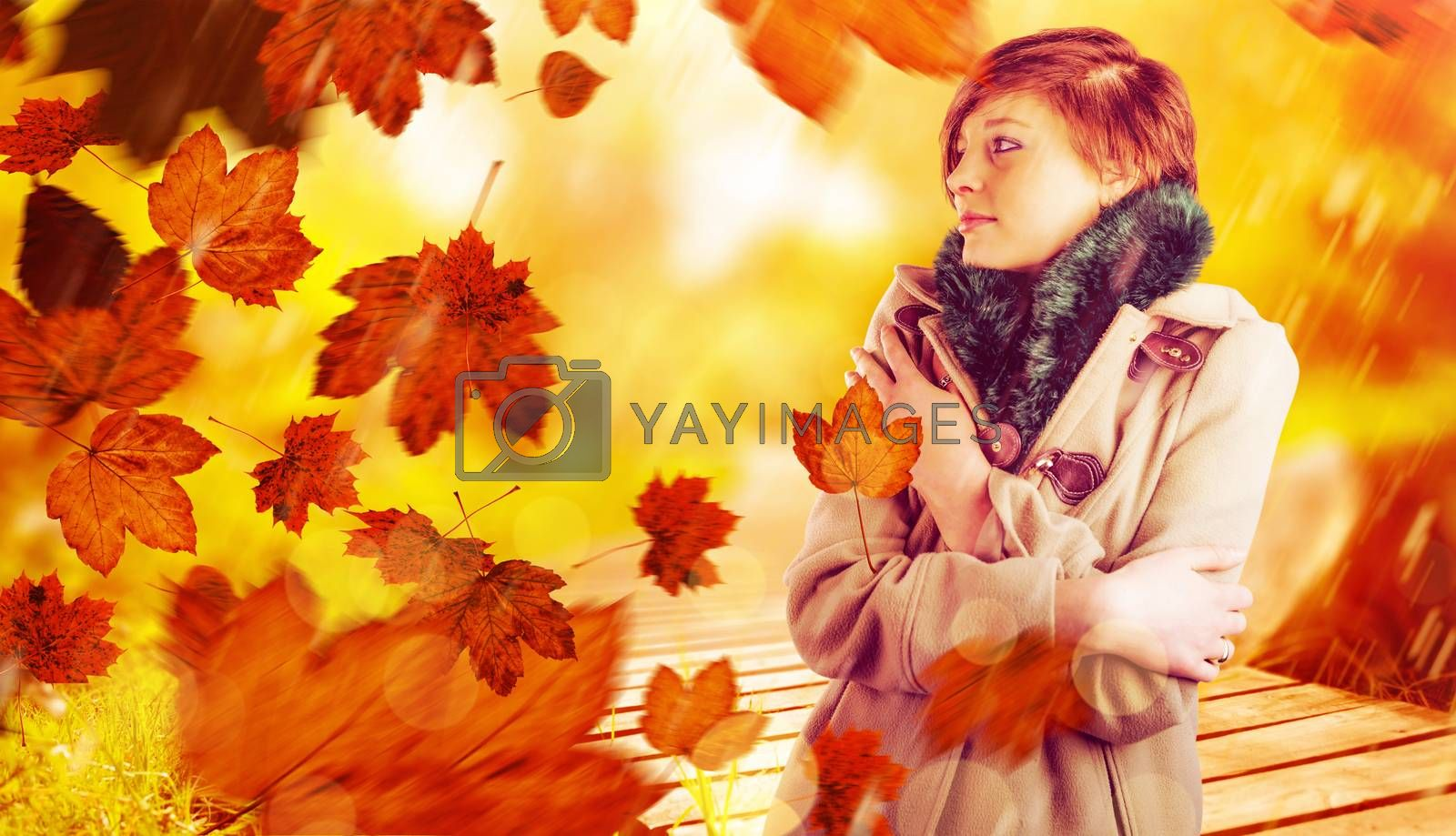 Composite image of thoughtful woman in winter coat by Wavebreakmedia
