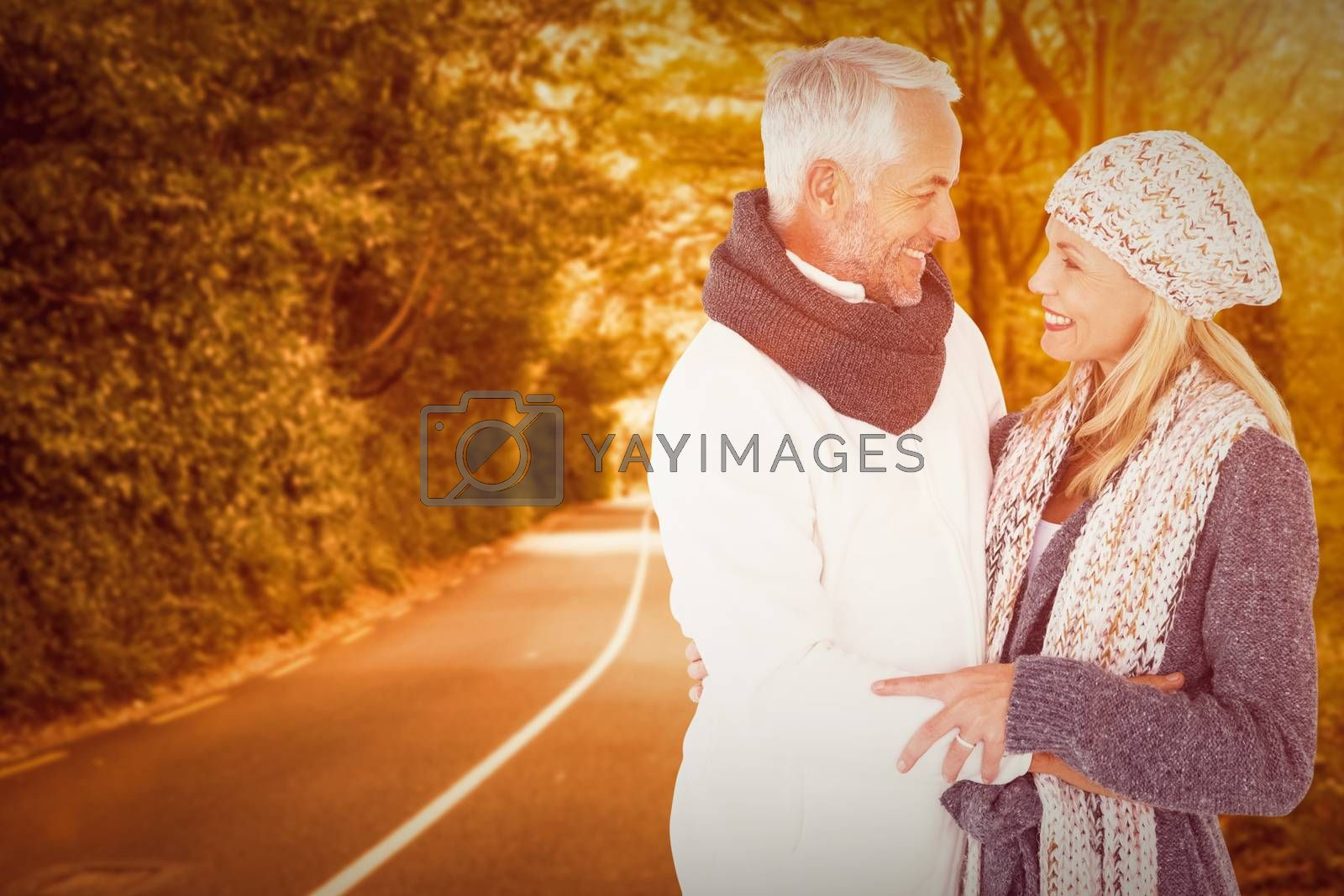 Cute happy couple romancing against country road