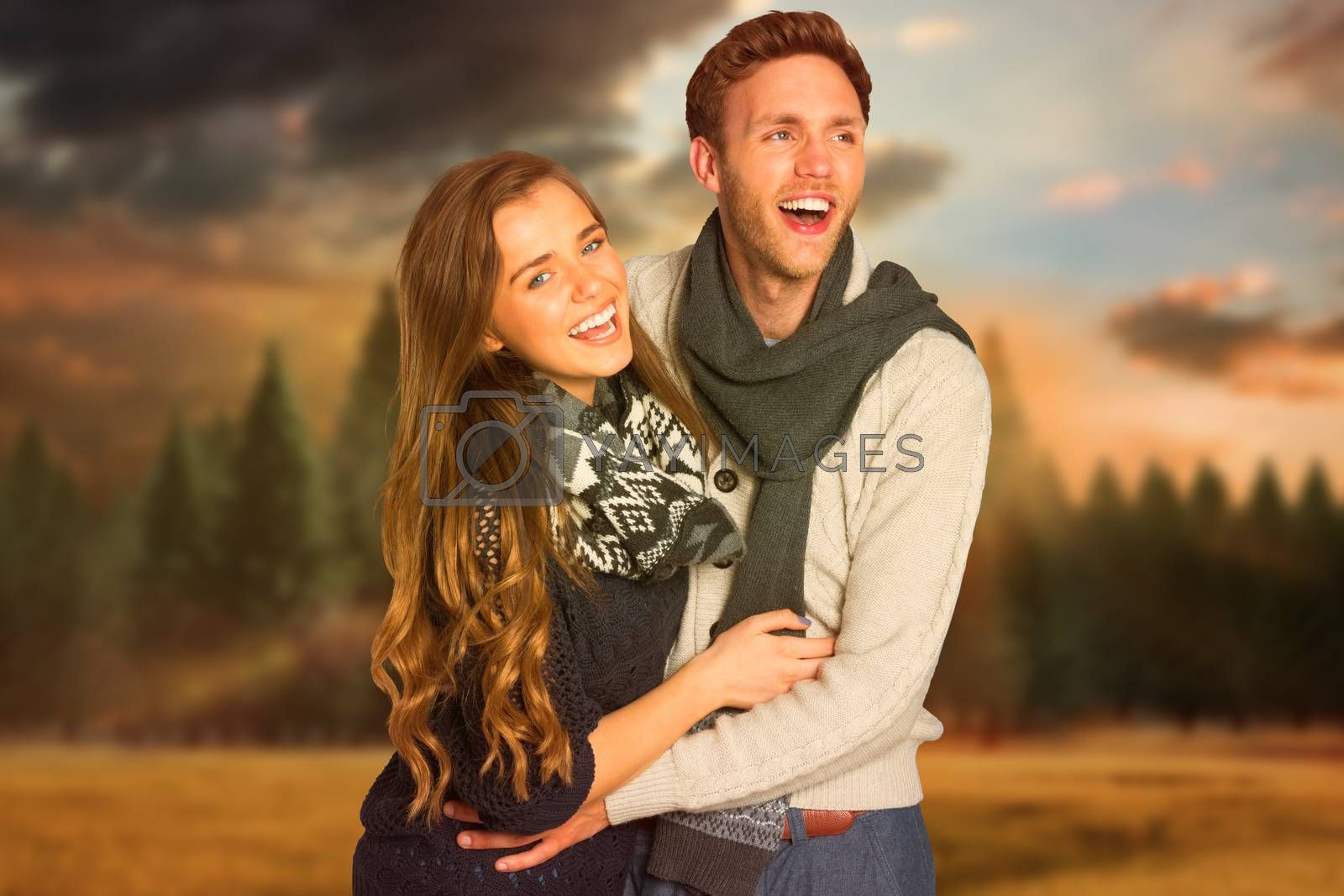 Composite image of happy young couple embracing by Wavebreakmedia