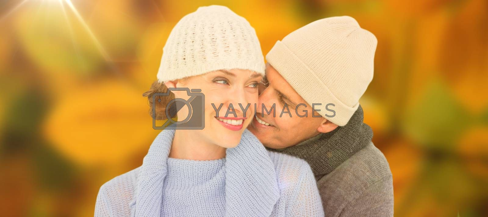 Casual couple in warm clothing against autumn scene