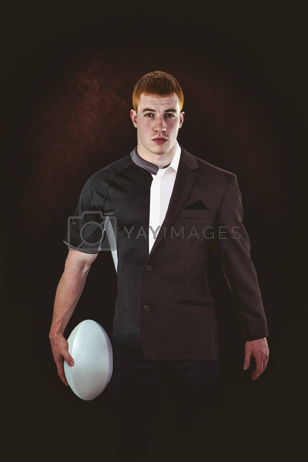 Rugby player holding a rugby ball against half a suit